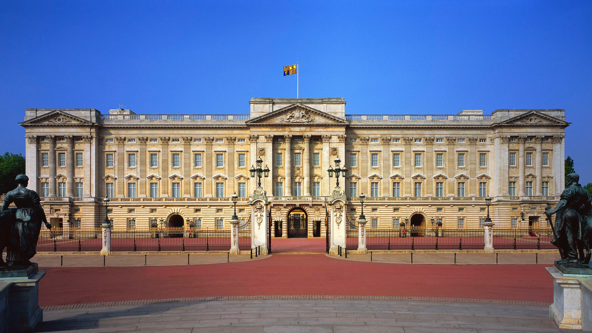 Buckingham palace on a sunny day with a clear blue sky in the background