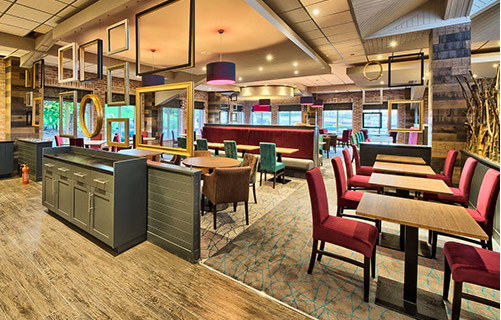 Modern dim lit restaurant with wooden and carpet flooring that is fitted with double stick systems