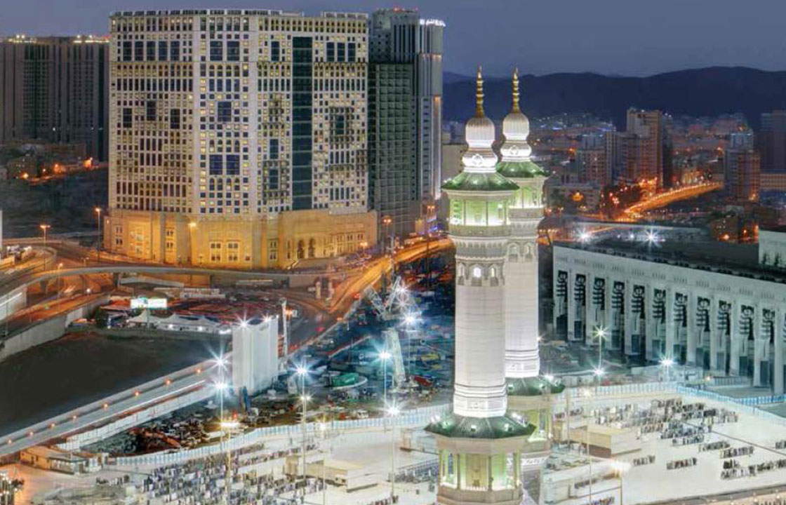 The Anjum Hotel Makkah Mecca in Saudi Arabia lit up at night surrounded by busy streets