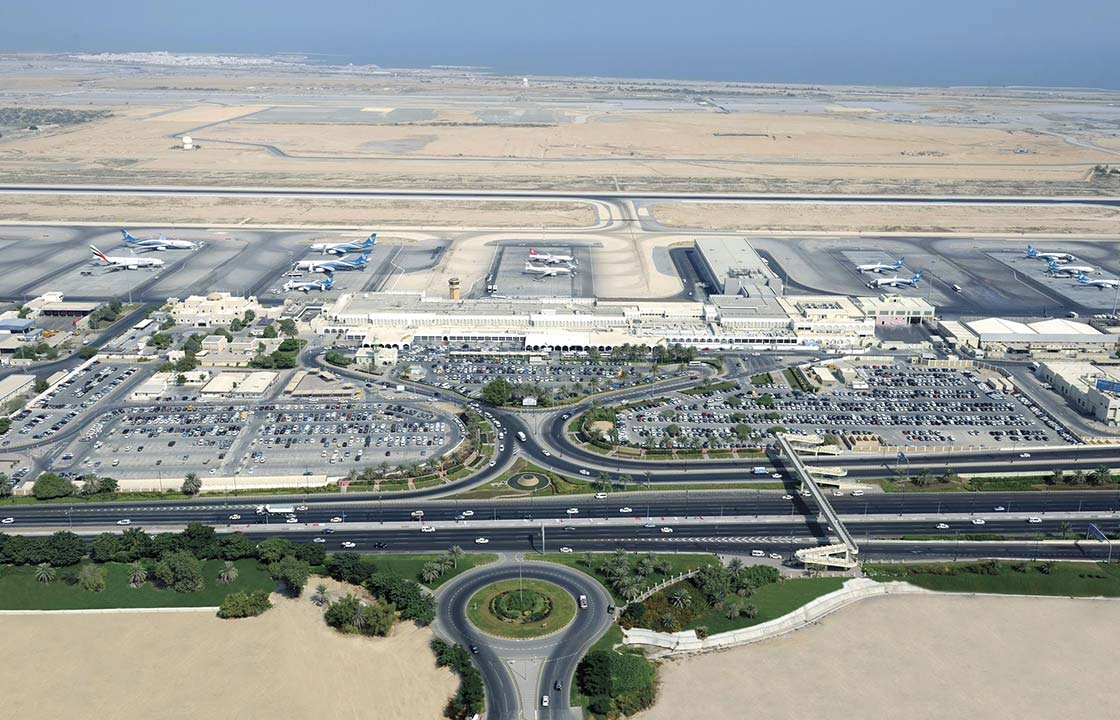 An arial view of the Muscat International Airport in Muscat Oman surrounded by a desert