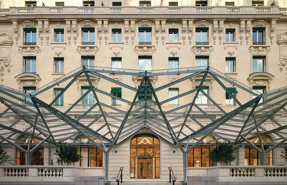 The glass and metal marquee at the front of the Peninsula hotel in Paris