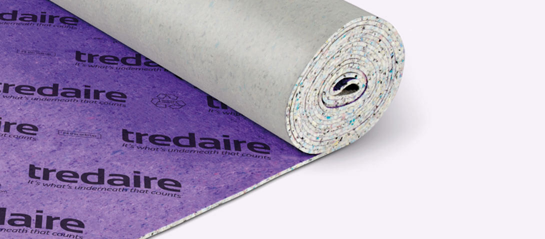 A roll of purple tredaire underlay on a white background