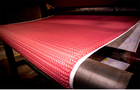 A sponge rubber underlay being made by a machine