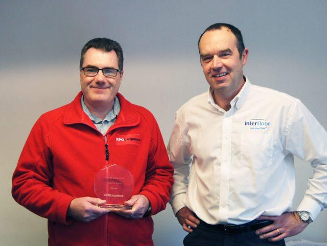 Wayne Robinson of XPO and Mark Jennings of Interfloor with the XPO award.