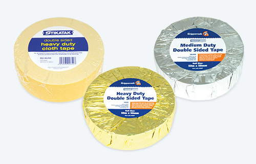 Three different packs of tape on a white background